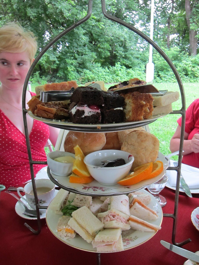 3 plates piled high with tasty afternoon tea snacks.